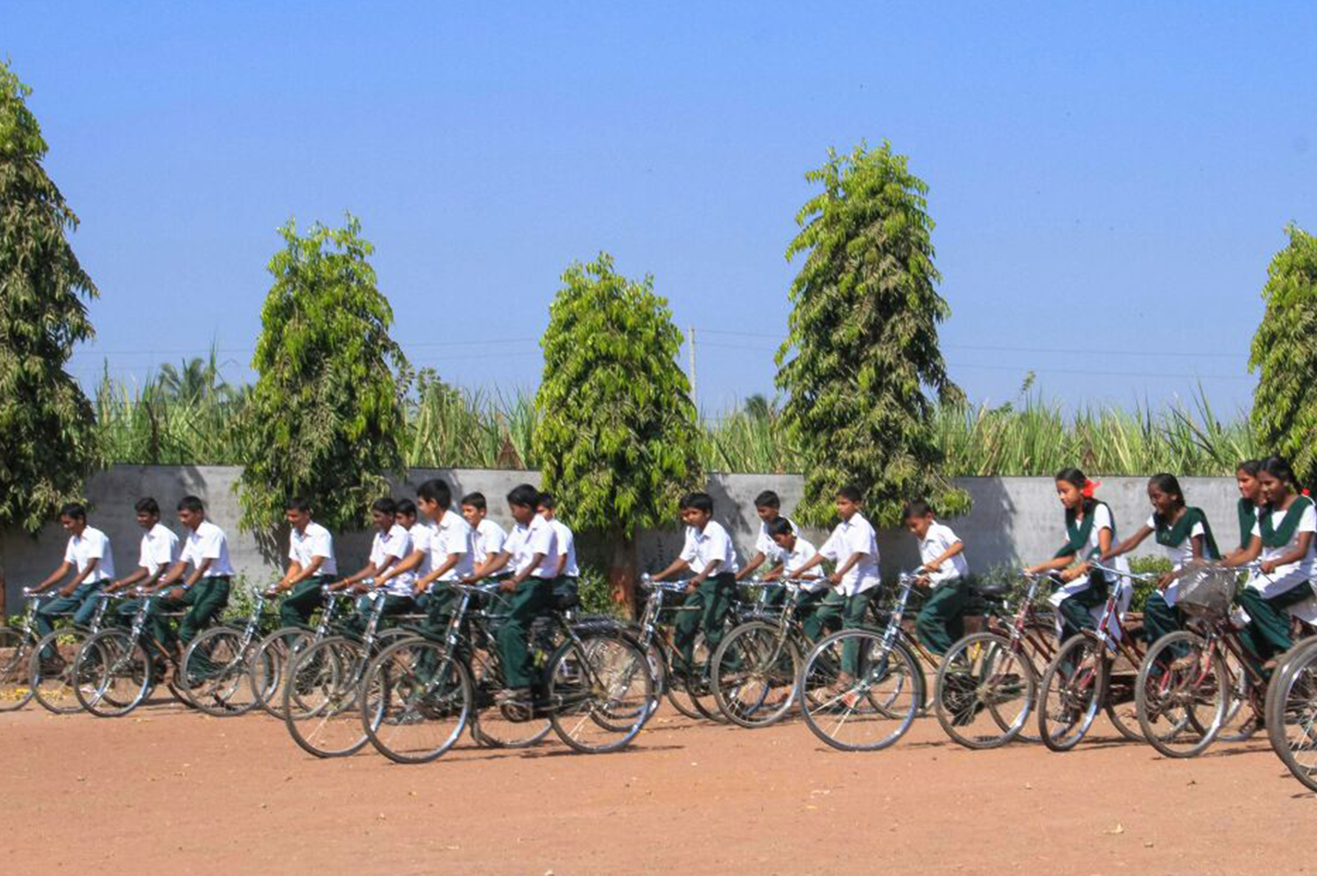 Distribution of educational material and bicycle to school students