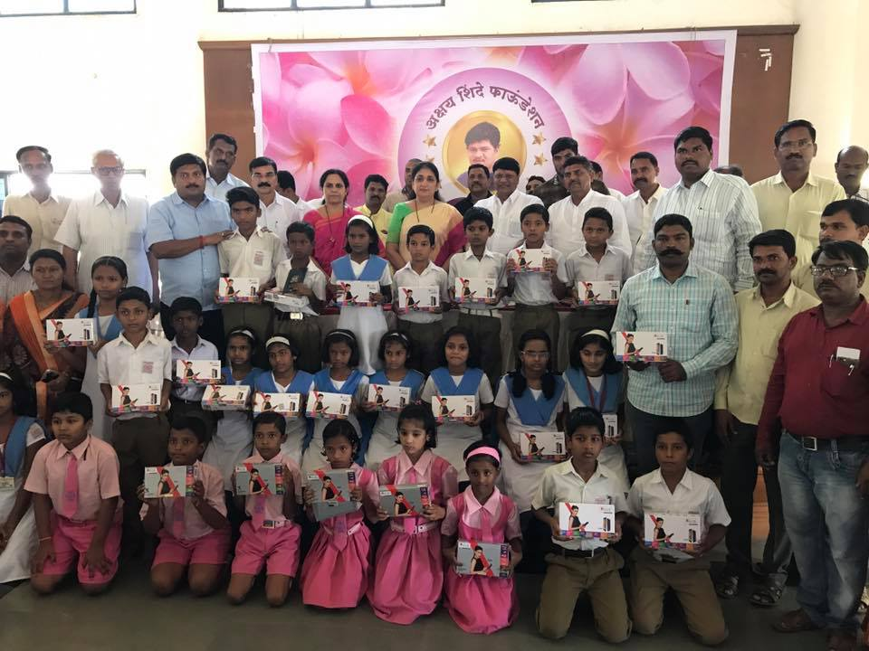 Tablet distribution to local students for educaional purposes, Jogvadi, Ta. Baramati